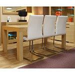 Nuvola krzesła z metalowymi płozami przy stole