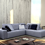 Flavio - aranżacja i inspiracja mebli tapicerowanych do salonu, narożnik z dużymi poduszkami zamiast klasycznego oparcia, szara elegancka tkanina, poduszki szare, w pasy, czarne, ciemnoszare