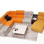 Infinity kolorówa sofa w salonie szare i pomarańczowe oparcia, żółta otomana
