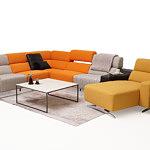 Infinity pomysł na salon z kolorową sofą kolor szary pomarańczowy żółty