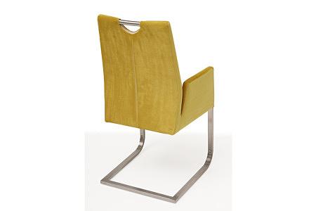 Nowoczesne krzesło tapicerowane na metalowych płozach z podłokietnikami