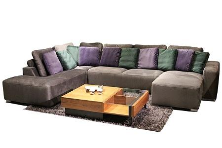 Flavio - wygodna i nowoczesna kanapa narożna z oparciem w postaci kolorówych poduszek, elegancki narożnik tkanina