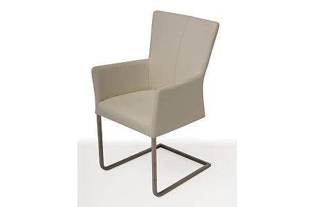 Tapicerowane krzesło z metalowymi płozami