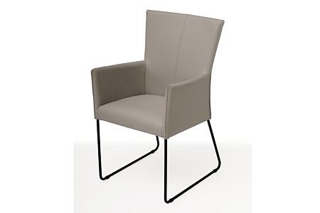 wygodne, ładne tapicerowane krzesło na metalowych płozach