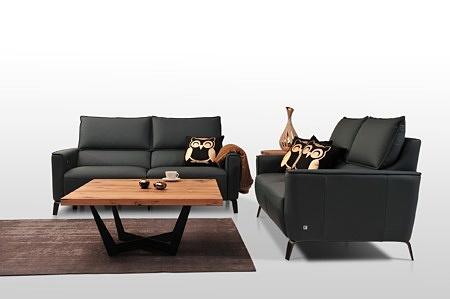 Aviva II - nowoczesne sofy skórzane do eleganckiego salonu i wnętrz klasy premium, wykonane z czarnej skóry naturalnej, wysokie matowe nóżki w kolorze antracytu
